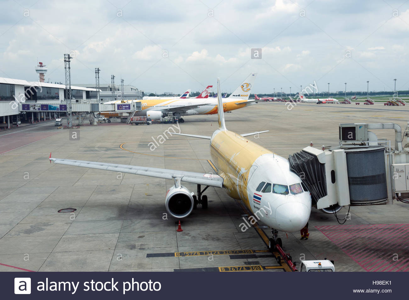 Bangkok Thailand Aircraft on the apron at Don Muang Airport. - Stock Image
