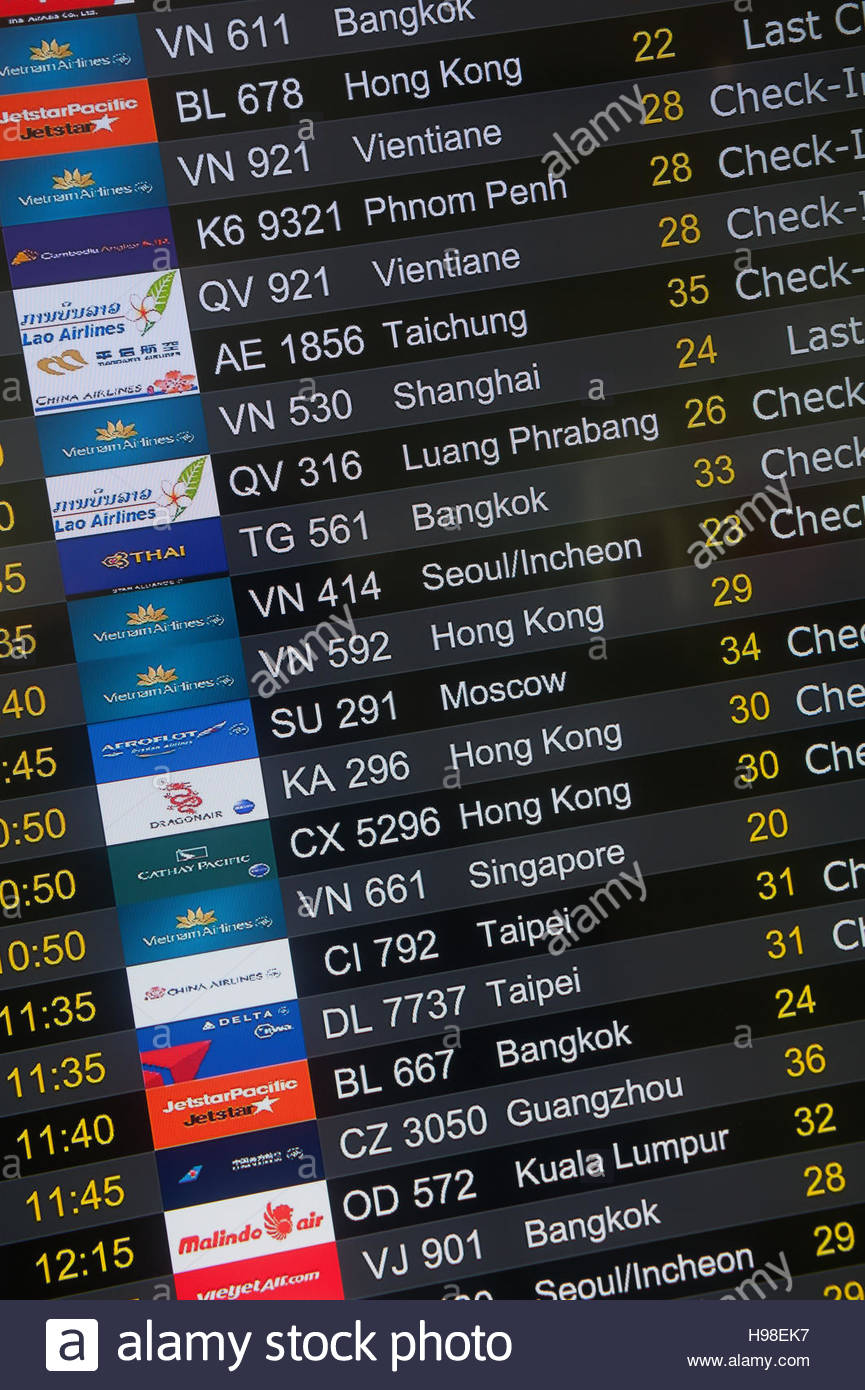Ha Noi Vietnam. Departures board at at Nội Bài International Airport - Stock Image