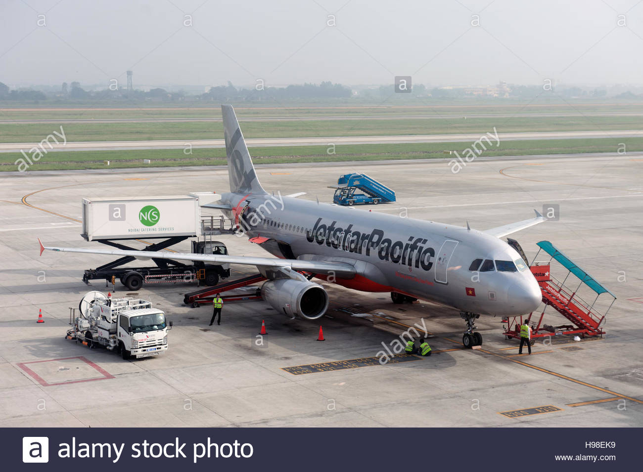 Ha Noi Vietnam. Jetstar Pacific aircraft on the apron at Nội Bài International Airport. VN-A556 Airbus A320 - Stock Image