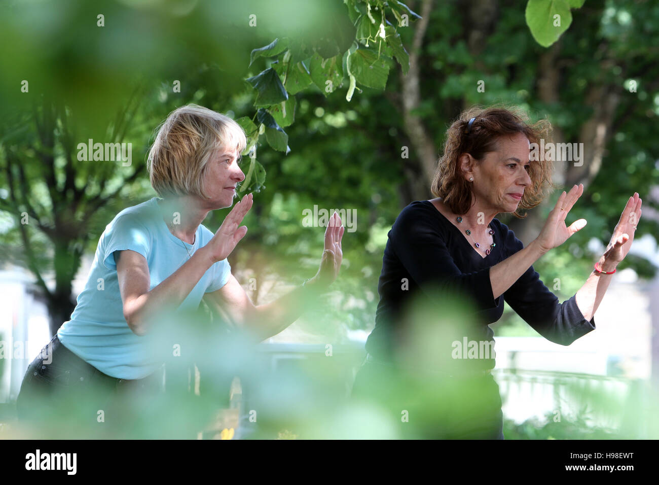 Tai Chi being practised by elderly caucasian women - Stock Image