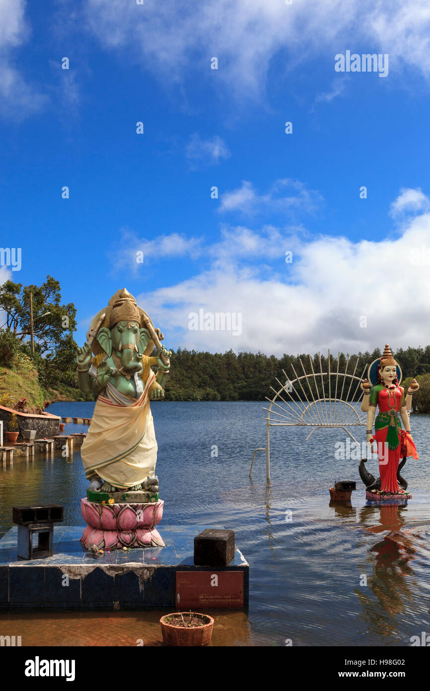 Statues of Hindu deities Lord Ganesh (left) and Goddess Ganga (right) outisde temple on the sacred lake of Grand - Stock Image