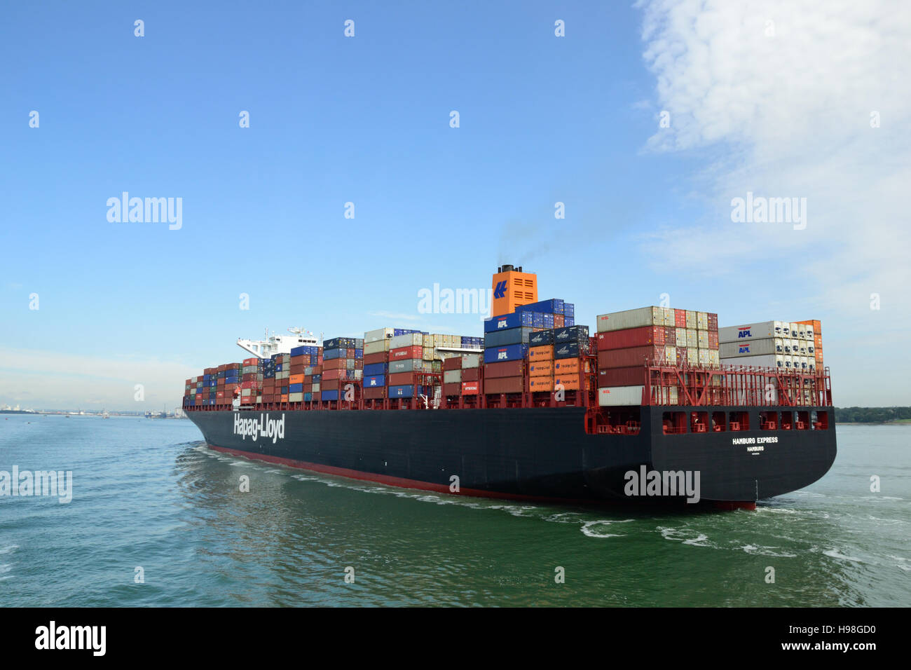 The Hamburg Express, container ship built in 2012 sailing up Southampton Water to the the port of Southampton. Stock Photo