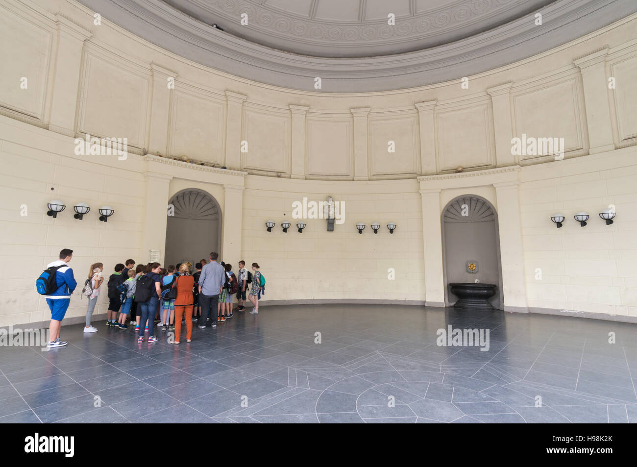 A party of schoolchildren visiting the Spa within the Elisenbrunnen building,  Aachen,  North Rhine-Westphalia, - Stock Image