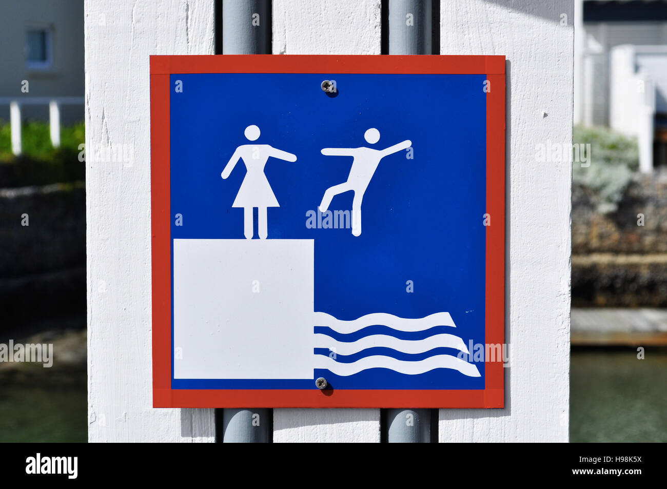 South Africa: warning sign for slippery ground at Thesen Islands, in the scenic Knysna estuary, on the famous Garden - Stock Image