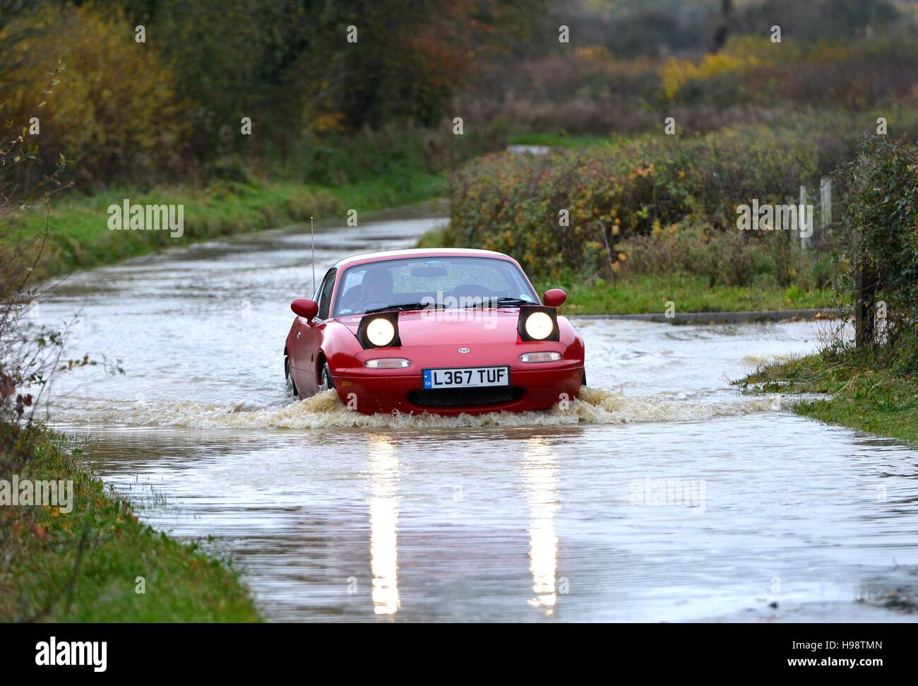 Selmeston, East Sussex. 20th November 2016. Flash flooding on roads after Storm Angus. Credit:  Peter Cripps/Alamy - Stock Image