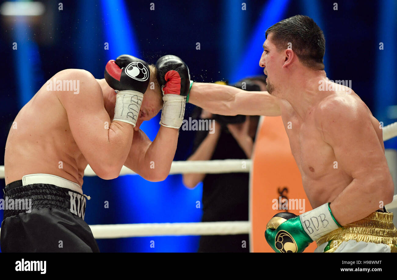 Hanover, Germany. 19th Nov, 2016. IBO World Champion Marco Huck (r) and Dmitro Kutscher from Ukraine in action during Stock Photo