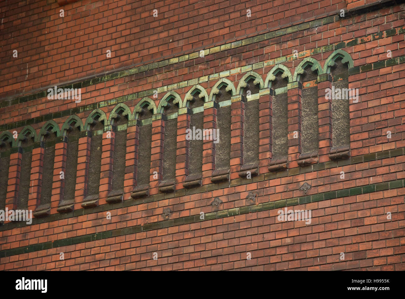 Ornaments of Gothic brick architecture at an outside wall of the Church of John the Baptist, Lüneburg, Germany - Stock Image