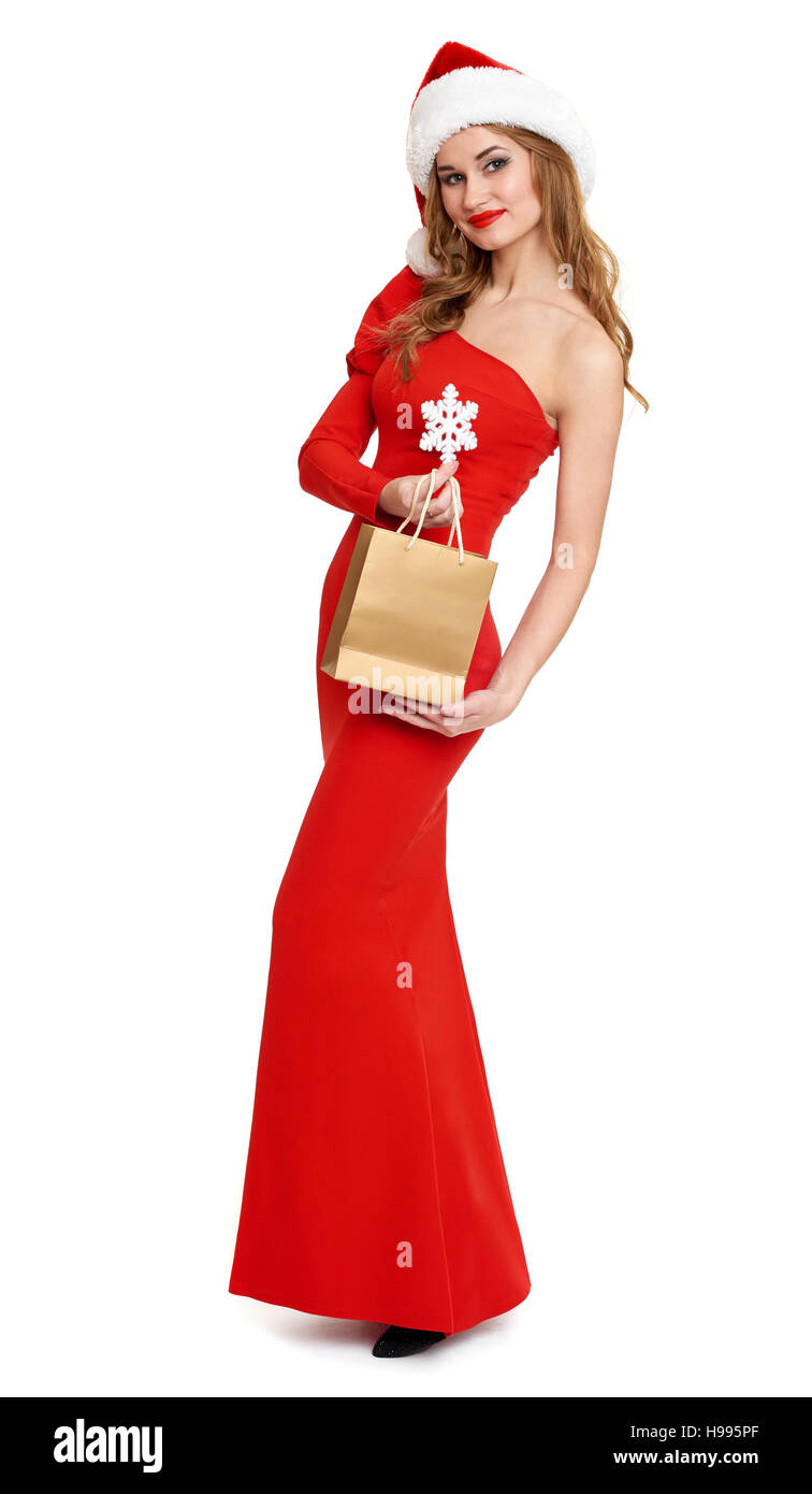 beautiful girl with shopping bag in red gown and santa hat isolated ...