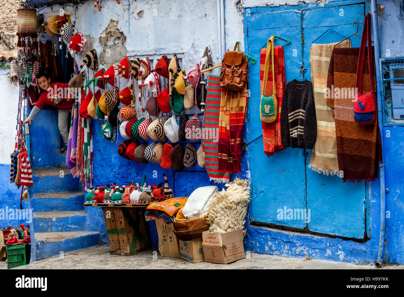 Souvenir Hats and Blankets For Sale In The Medina, Chefchaouen, Morocco - Stock Image