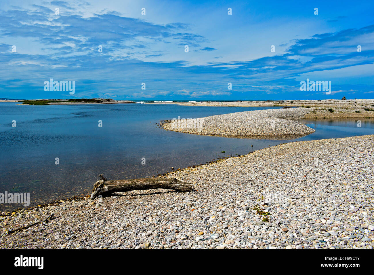 Inshore banks of shingle at the mouth of the River Spey, Spey Bay, Scotland, Great Britain - Stock Image