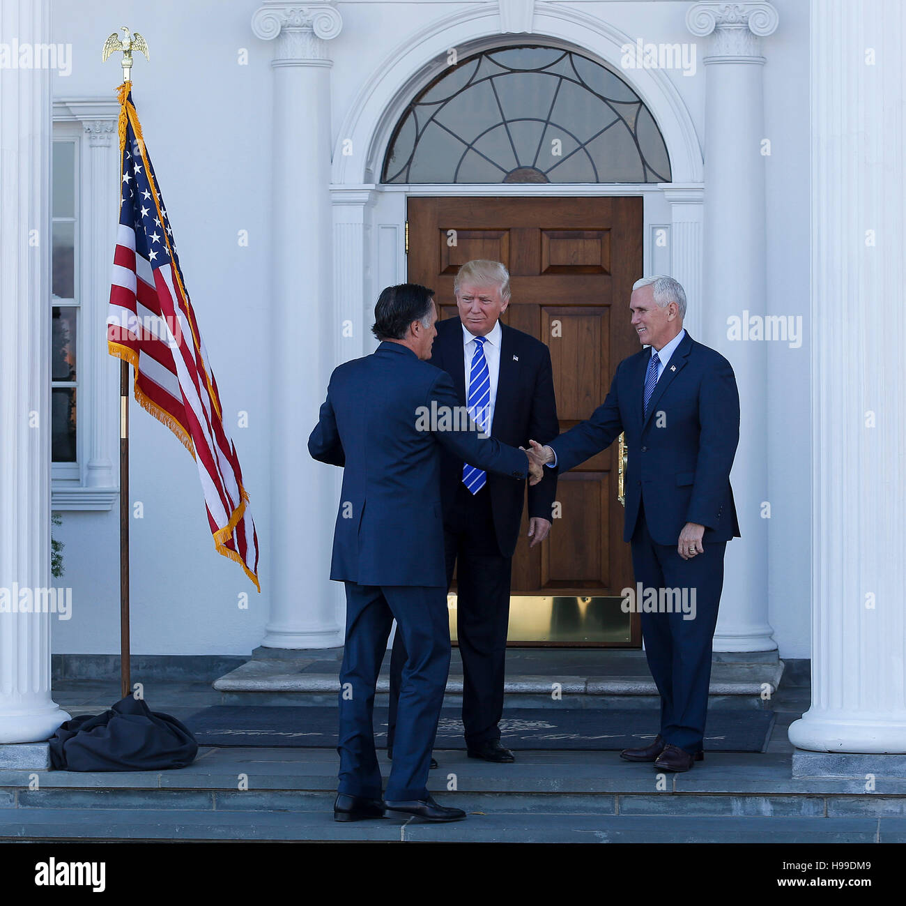 President elect Donald Trump and Vice President elect Mike Pence greet Mitt Romney at the clubhouse at Trump International Golf Club, November 19, 2016 in Bedminster Township, New Jersey. (Aude Guerrucci / Pool) *** Please Use Credit from Credit Field *** Stock Photo