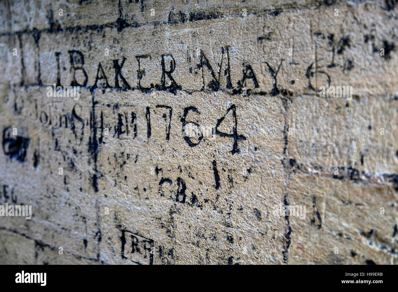 Old graffiti names carved on wall university church of st mary the virgin oxford england uk