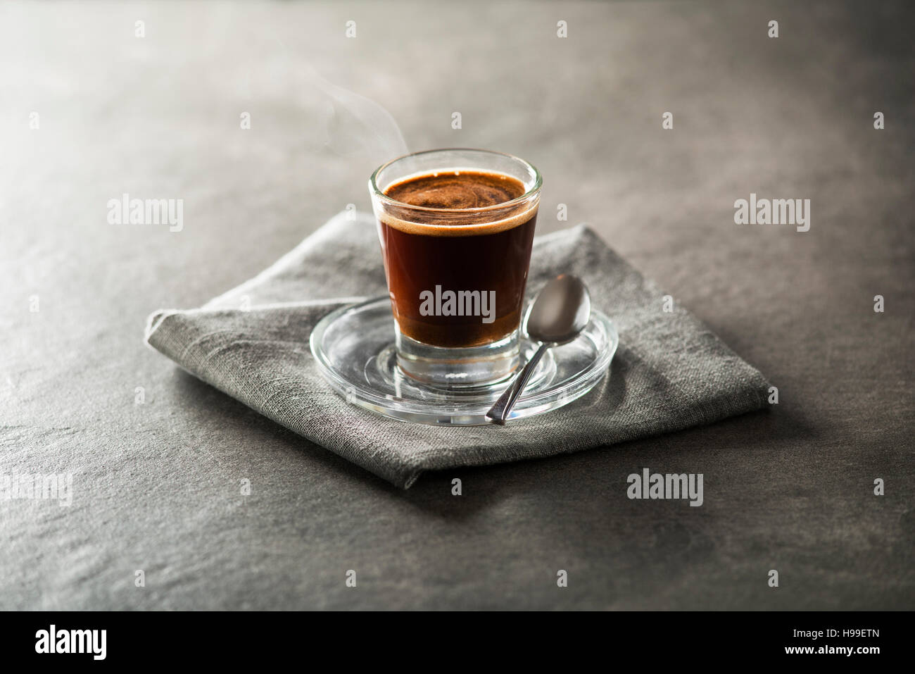 Cup of espresso coffee on dark background. - Stock Image