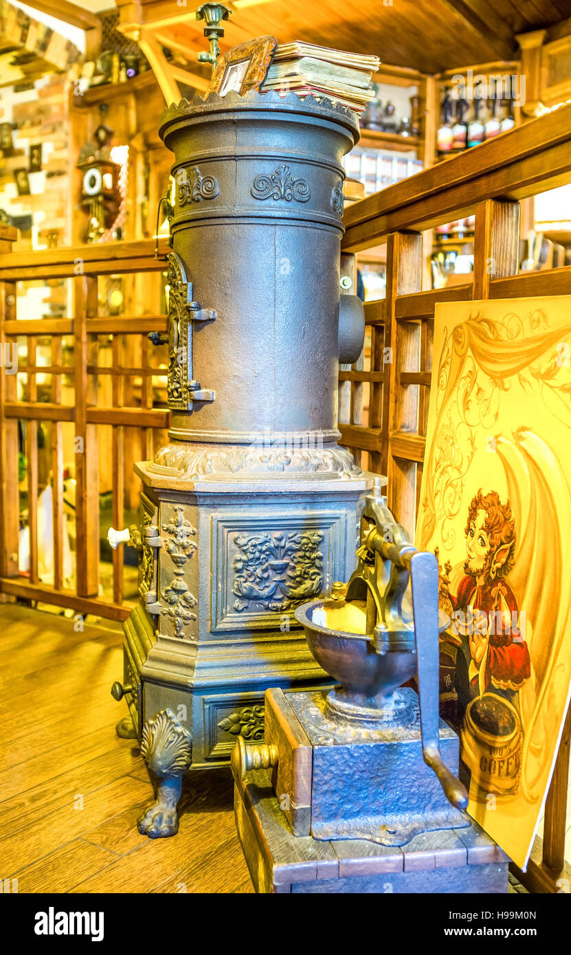 The cast iron potbelly stove is an element of decoration of the local cafe in old Odessa - Stock Image