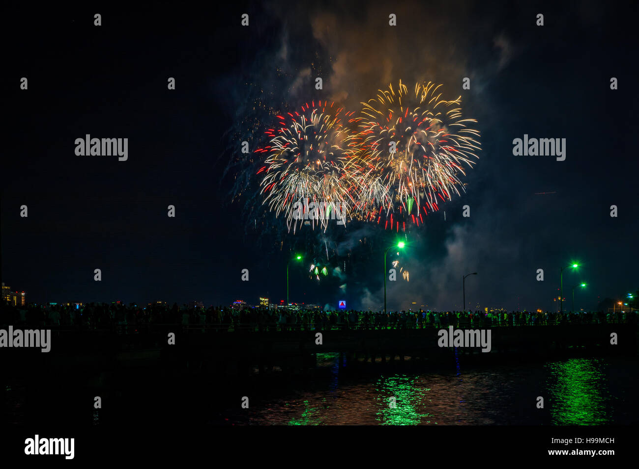 Fourth of July fireworks over the Broad Canal at night, in Cambridge, Massachusetts. Stock Photo