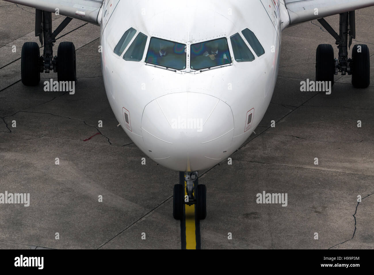 Closeup view of an aircraft preparing to take off - Stock Image