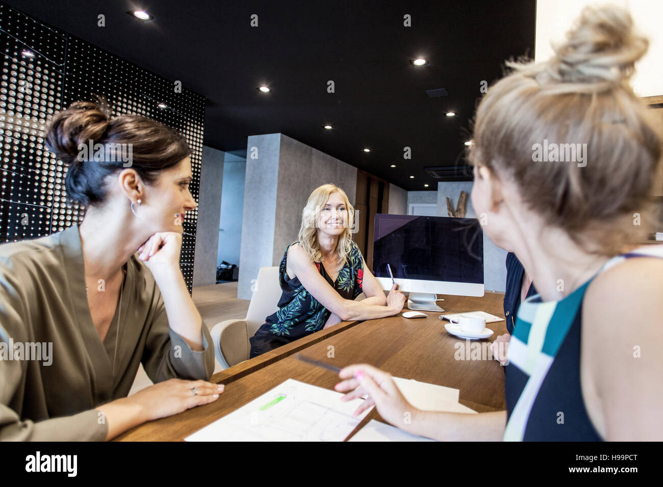 Group of businesswomen having a meeting - Stock Image