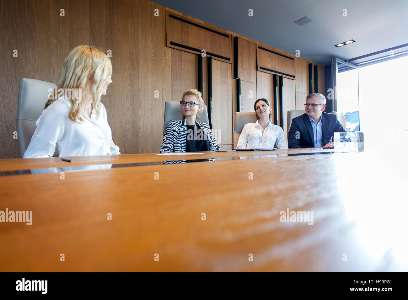Business people having a meeting in board room - Stock Image