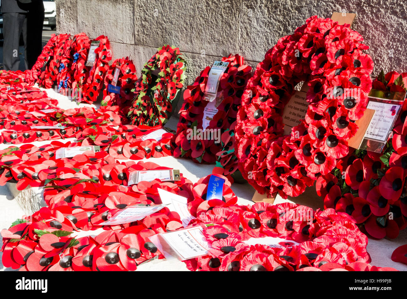 Wreaths surround the Cenotaph on Whitehall on Armistice Day  in London, UK - Stock Image