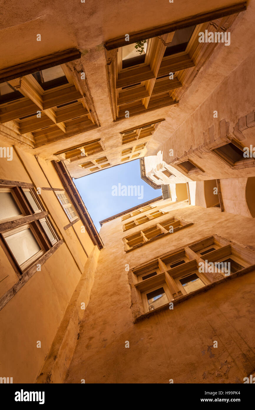 Looking up at the sky from one of the many traboules in Vieux Lyon. - Stock Image