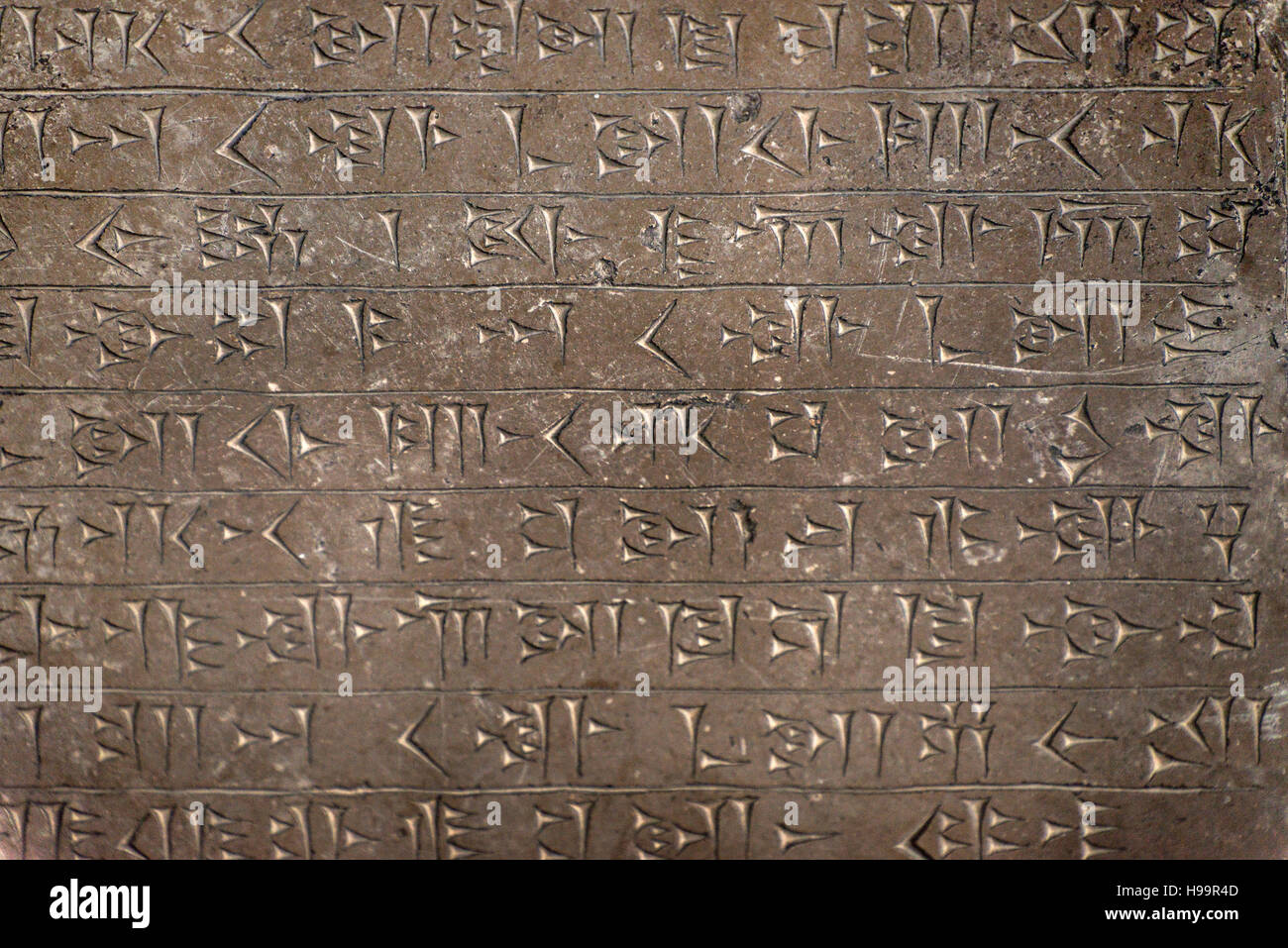 Cuneiform carved scriptures at Archaeological Museum of Tehran, Iran - Stock Image