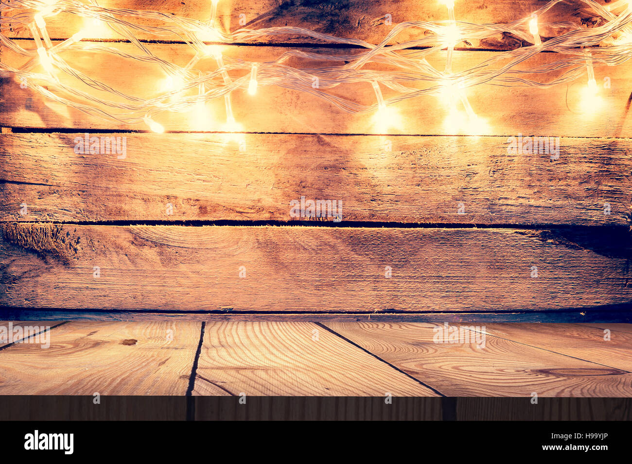 Christmas Light On Wooden Background And Table Vintage Decoration With Lights Space