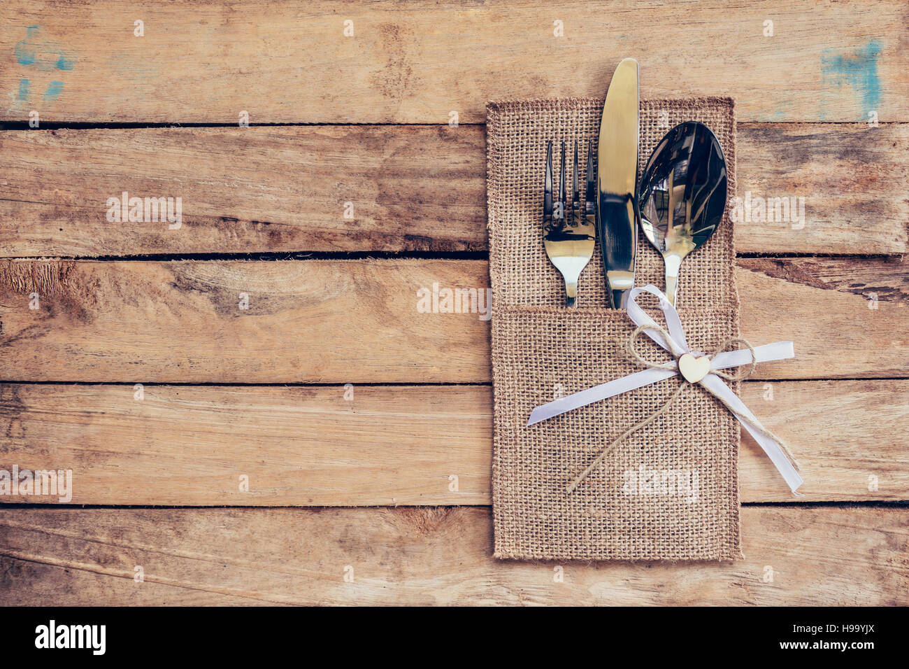 Christmas table place setting and silverware on wood with space and ...
