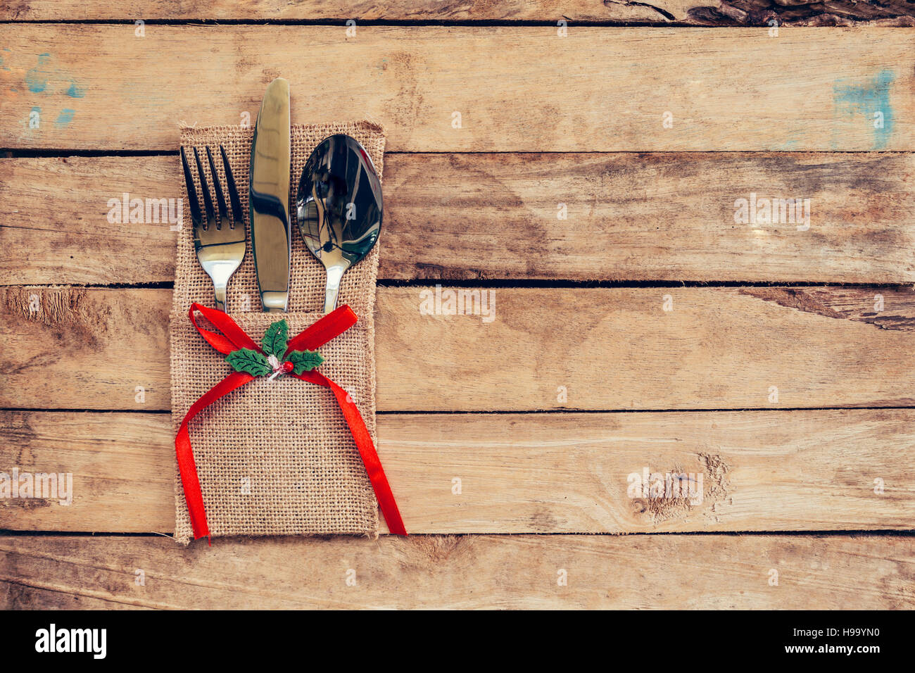 Christmas table place setting and silverware on wood with space and Table setting on wood background vintage. & Christmas table place setting and silverware on wood with space and ...