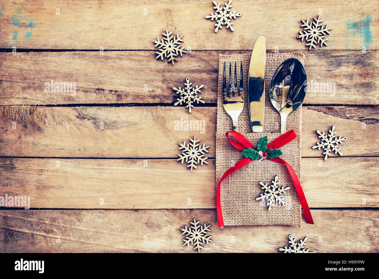 christmas table place setting and silverware snowflakes on table wooden background with space for christmas.  sc 1 st  Alamy & christmas table place setting and silverware snowflakes on table ...