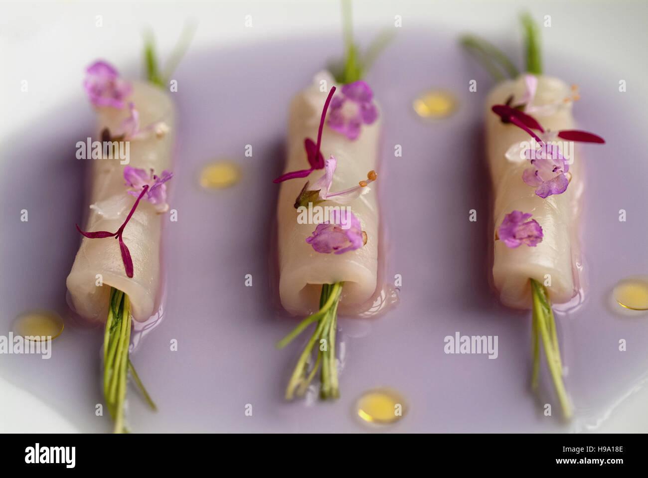 Raw scallop ravioli in a purple cauliflower consume at Restaurant Andre in Singapore - Stock Image