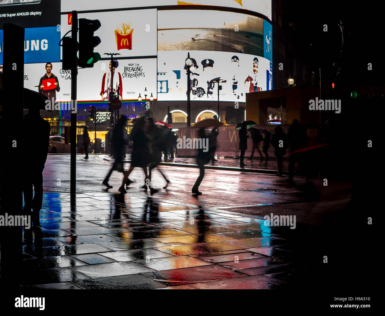 Rain reflects Piccadilly Circus lights in Central London Stock Photo