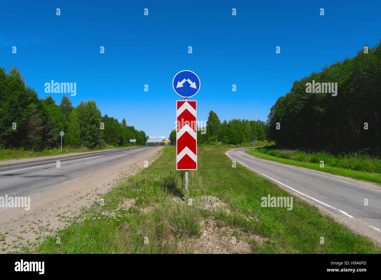 Road sign with arrows. Two different directions. Concept of choose the correct way. Right and left directional traffic - Stock Image