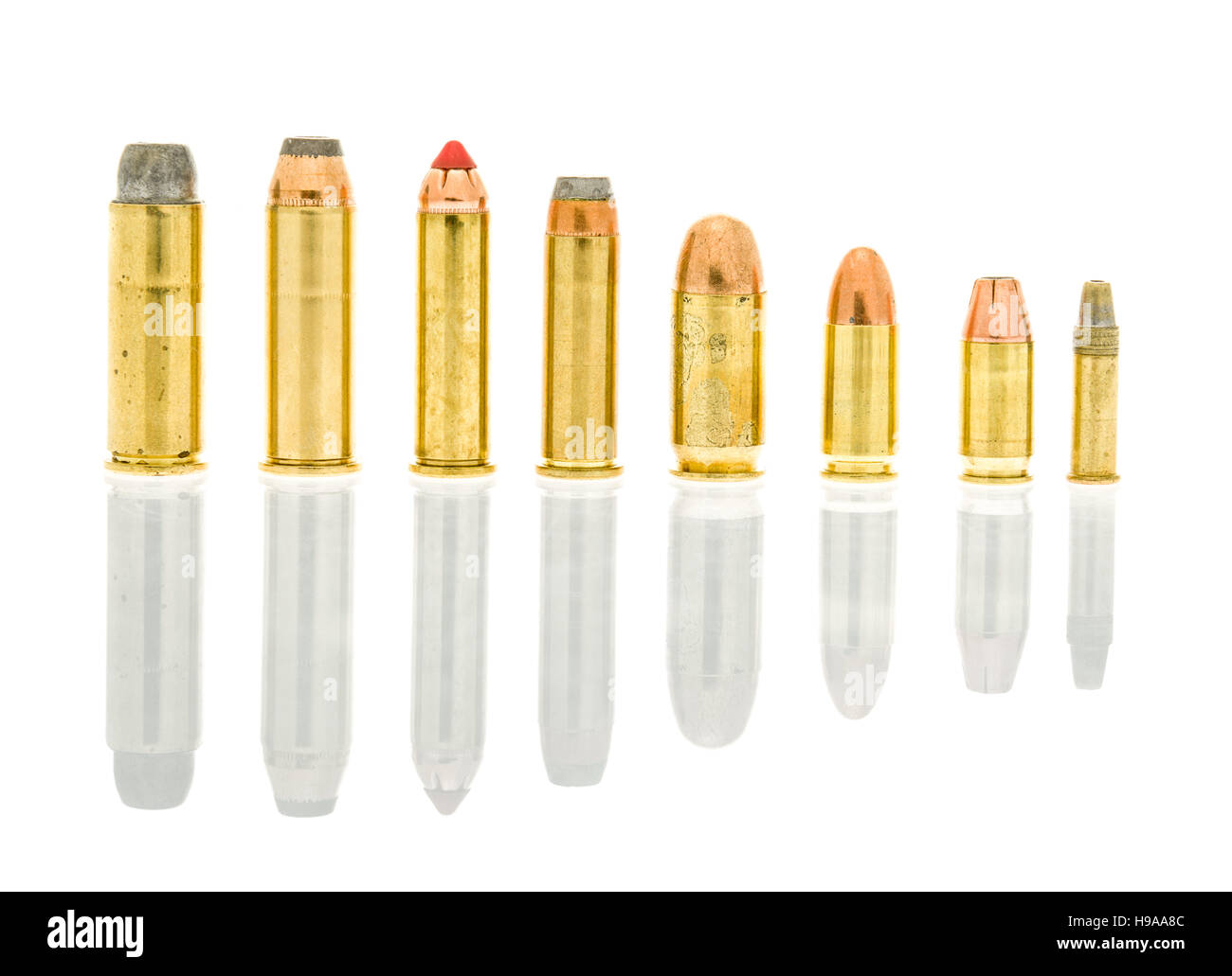 Hand gun caliber bullets on an isolated background including 45 long colt, 44 rem mag, 357 mag, 38 special, 45 acp, - Stock Image