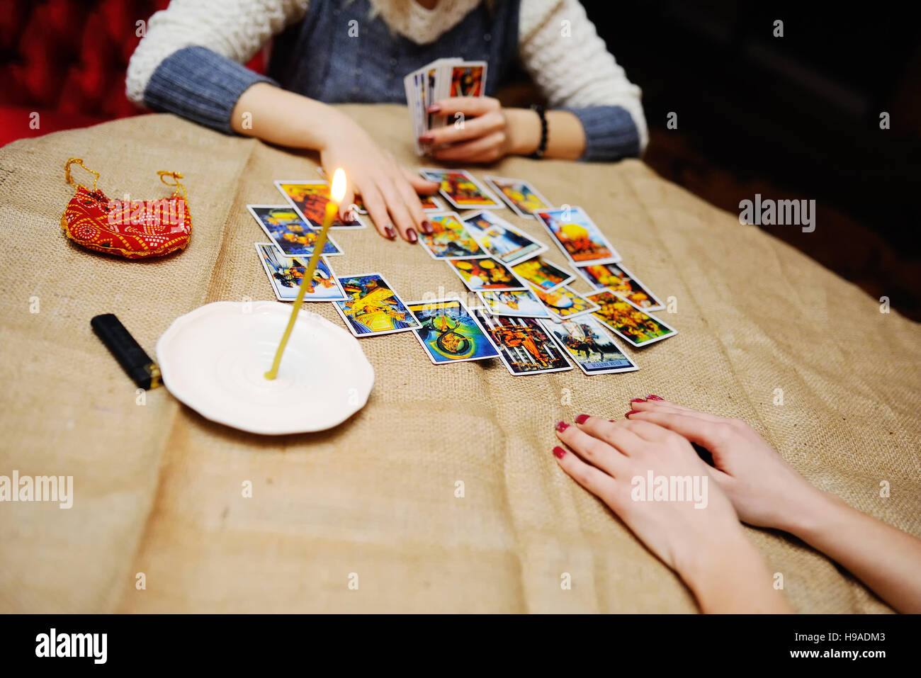 Divination by the Tarot cards. The fortune teller predicts the f - Stock Image