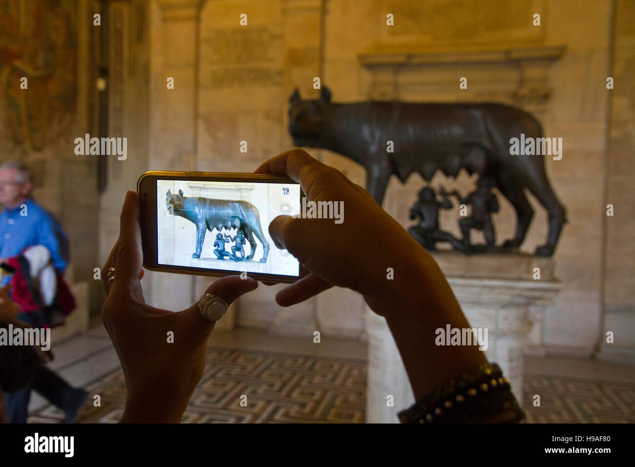 Capitoline Wolf statue, tourist shotting photos mobile Rome, italy, capitoline museums, musei capitolini, art touristic - Stock Image
