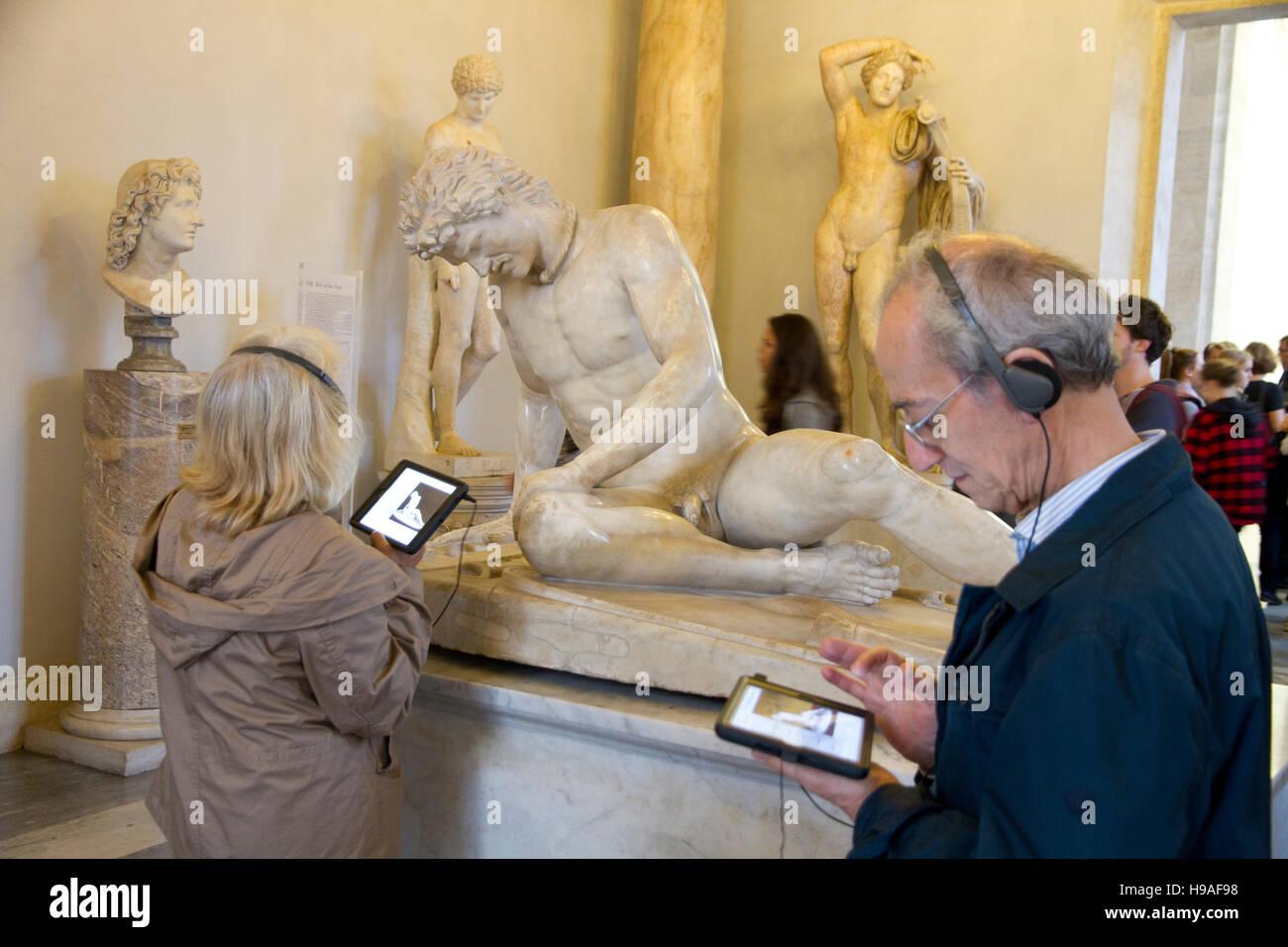 Tourist looking statue art scene Rome, italy, capitoline museums,  musei capitolini, art heritage touristic landmark - Stock Image