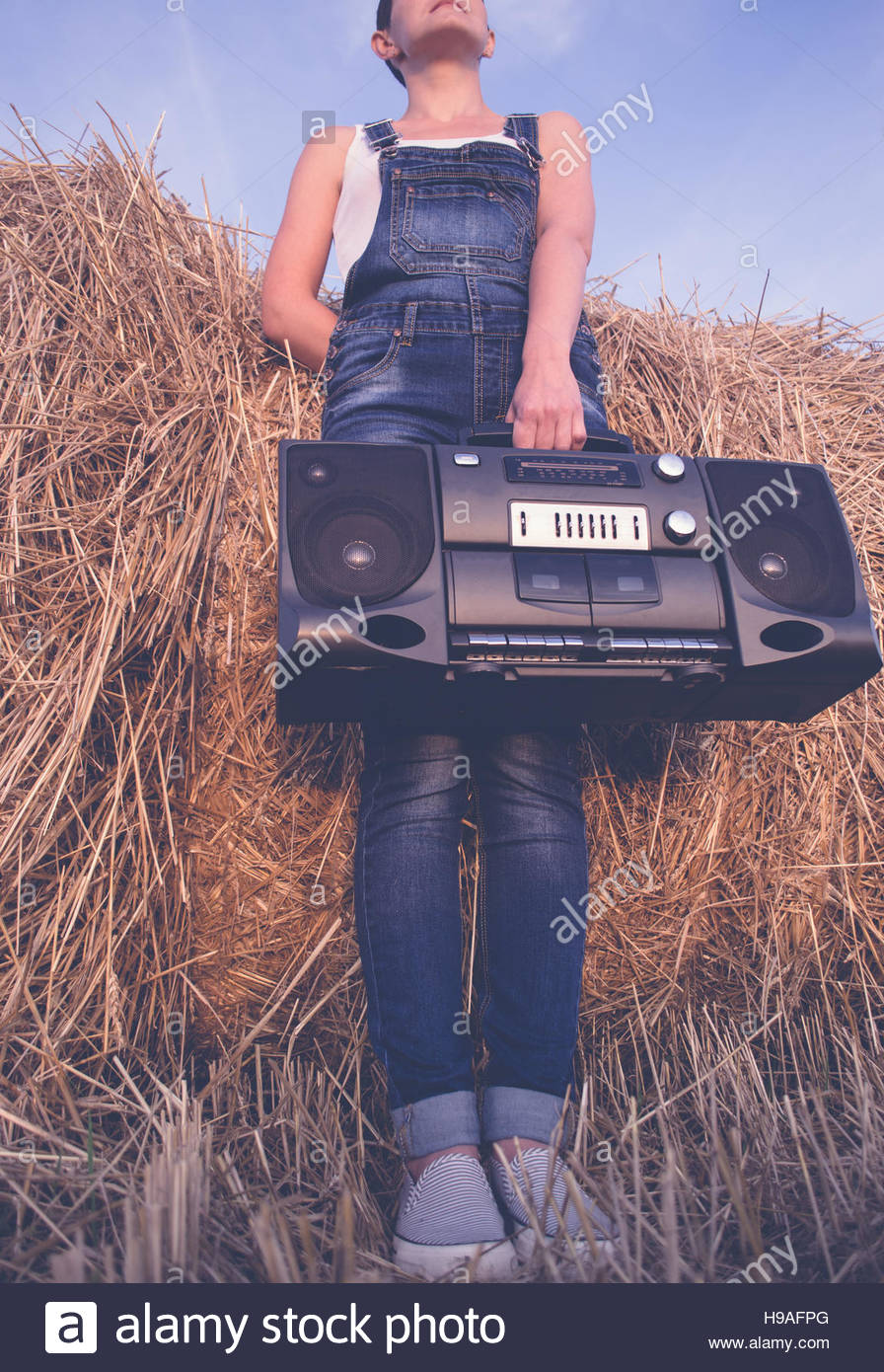Woman holding an old cassette recorder - Stock Image