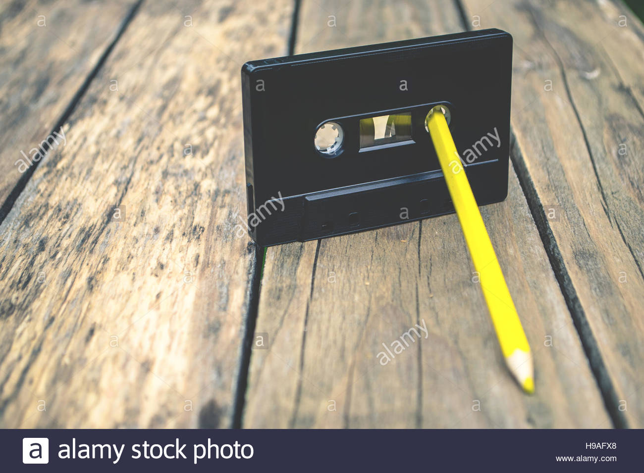 Old audiotape and pencil - Stock Image