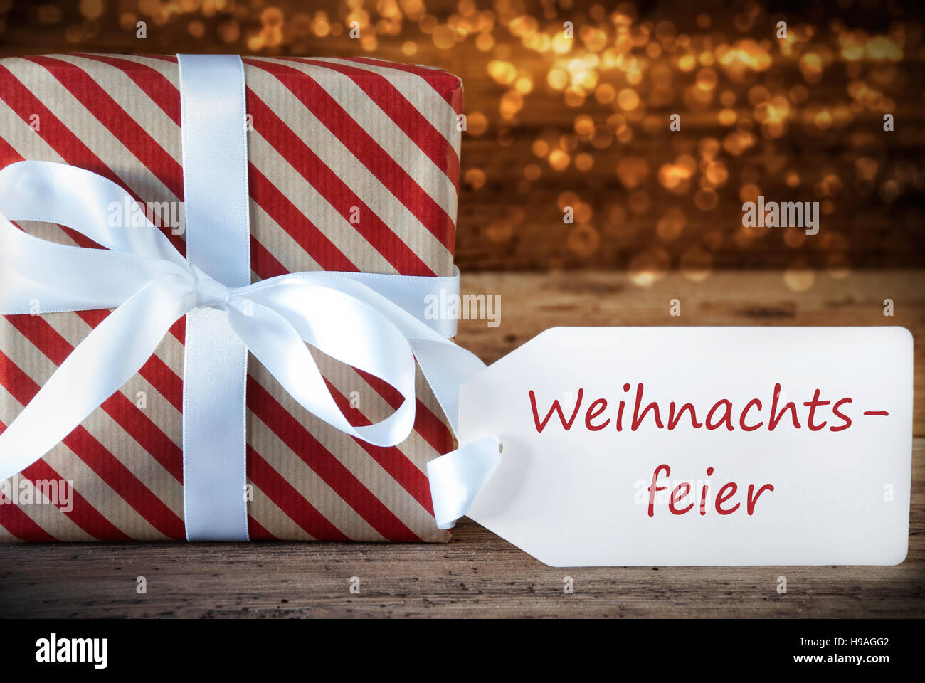 Atmospheric gift with label weihnachtsfeier means christmas party