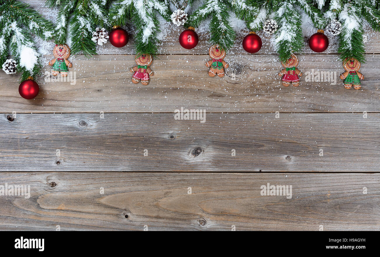 Christmas Top Border.Top Border Of Christmas Objects And Snow On Rustic Wood For