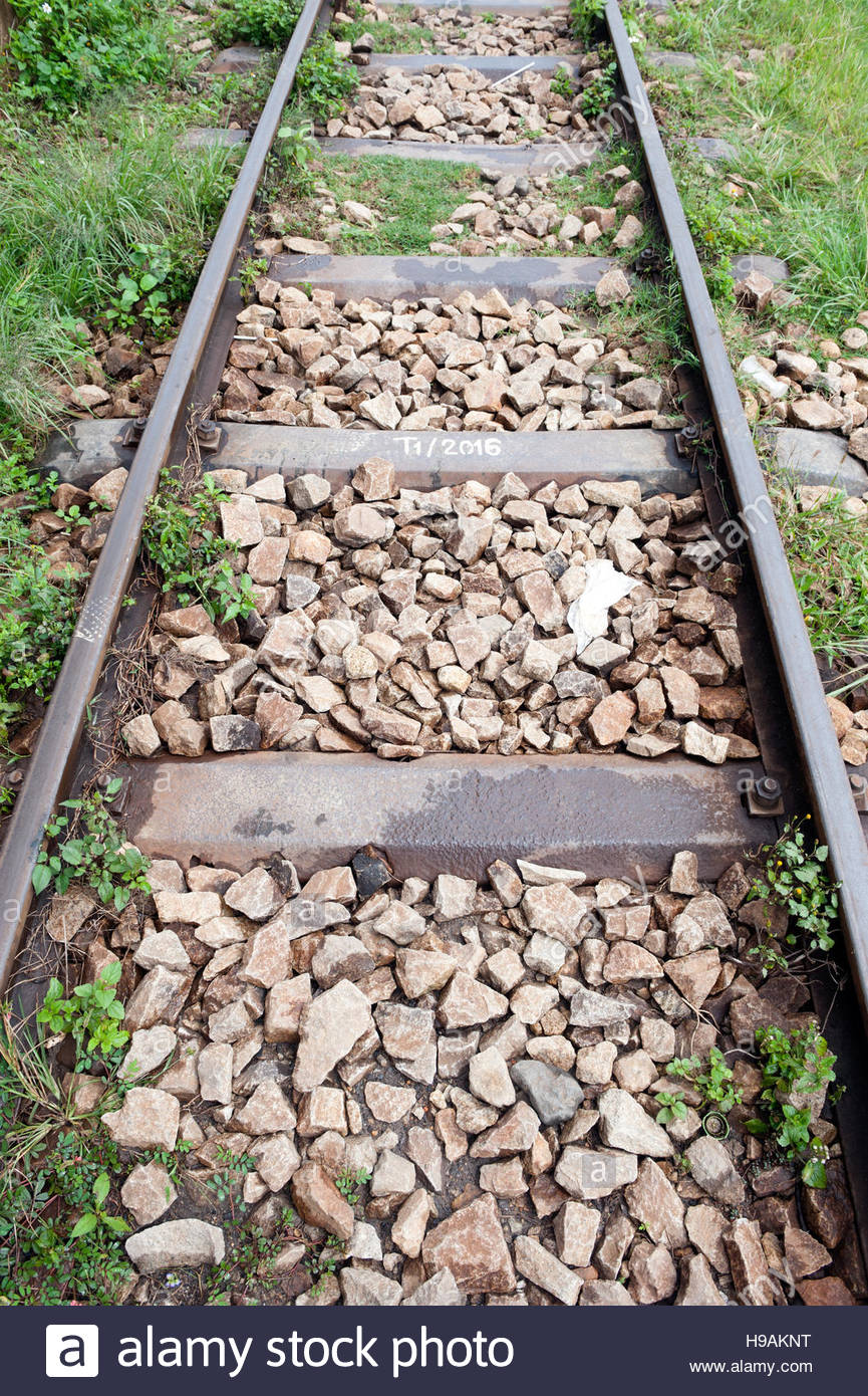 Dalat Vietnam Dalat Railways station. Rail track with metal sleepers and ballast stones. - Stock Image