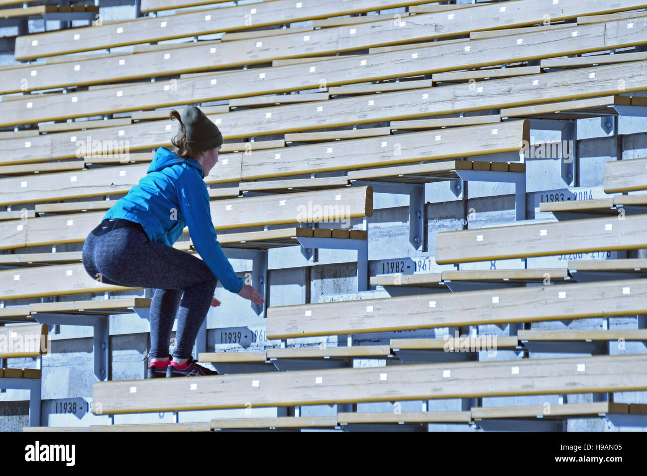Jumping in stairs. Young woman training. - Stock Image