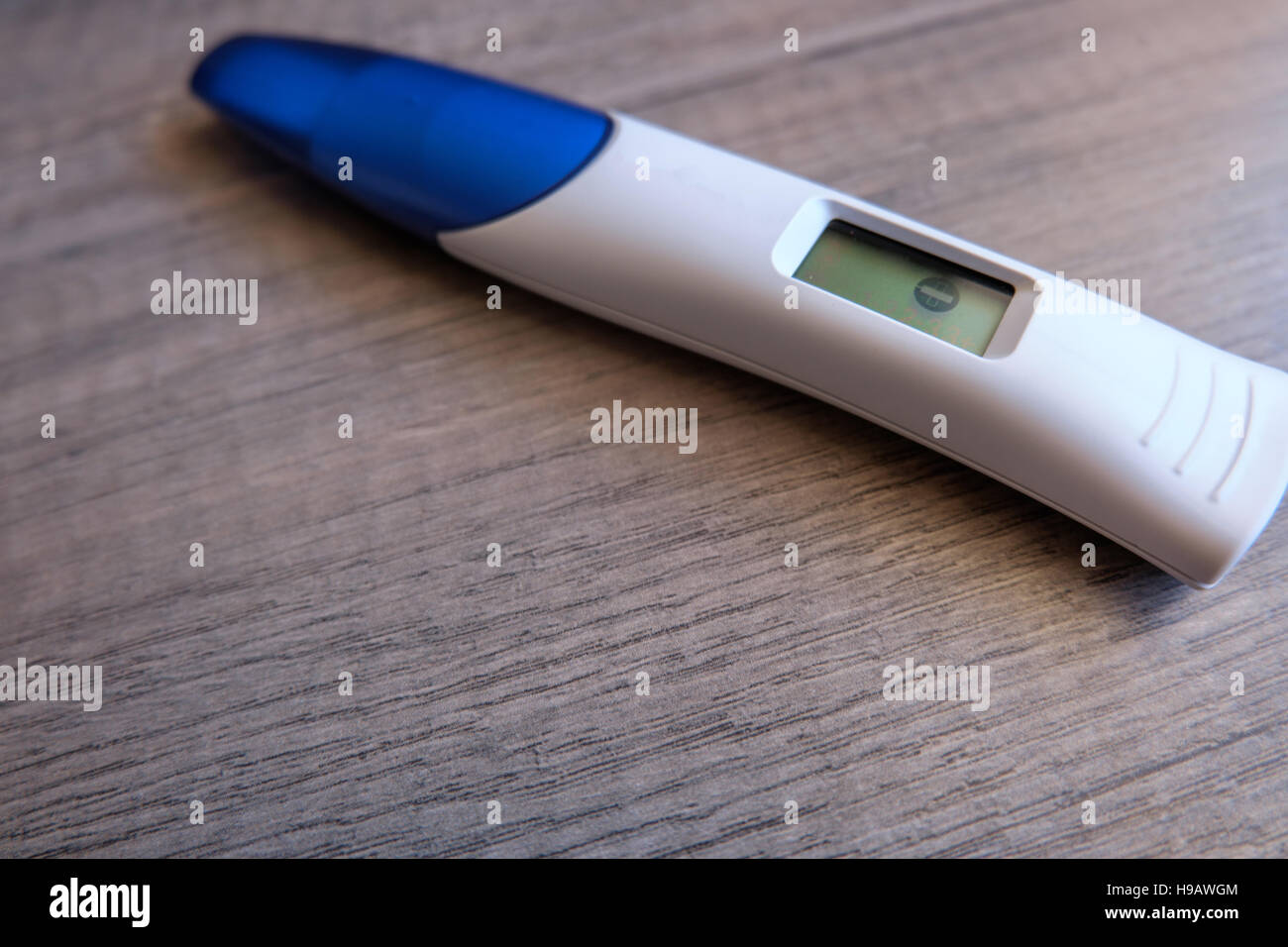 Digital Pregnancy Test With Negative Result On Wooden Background