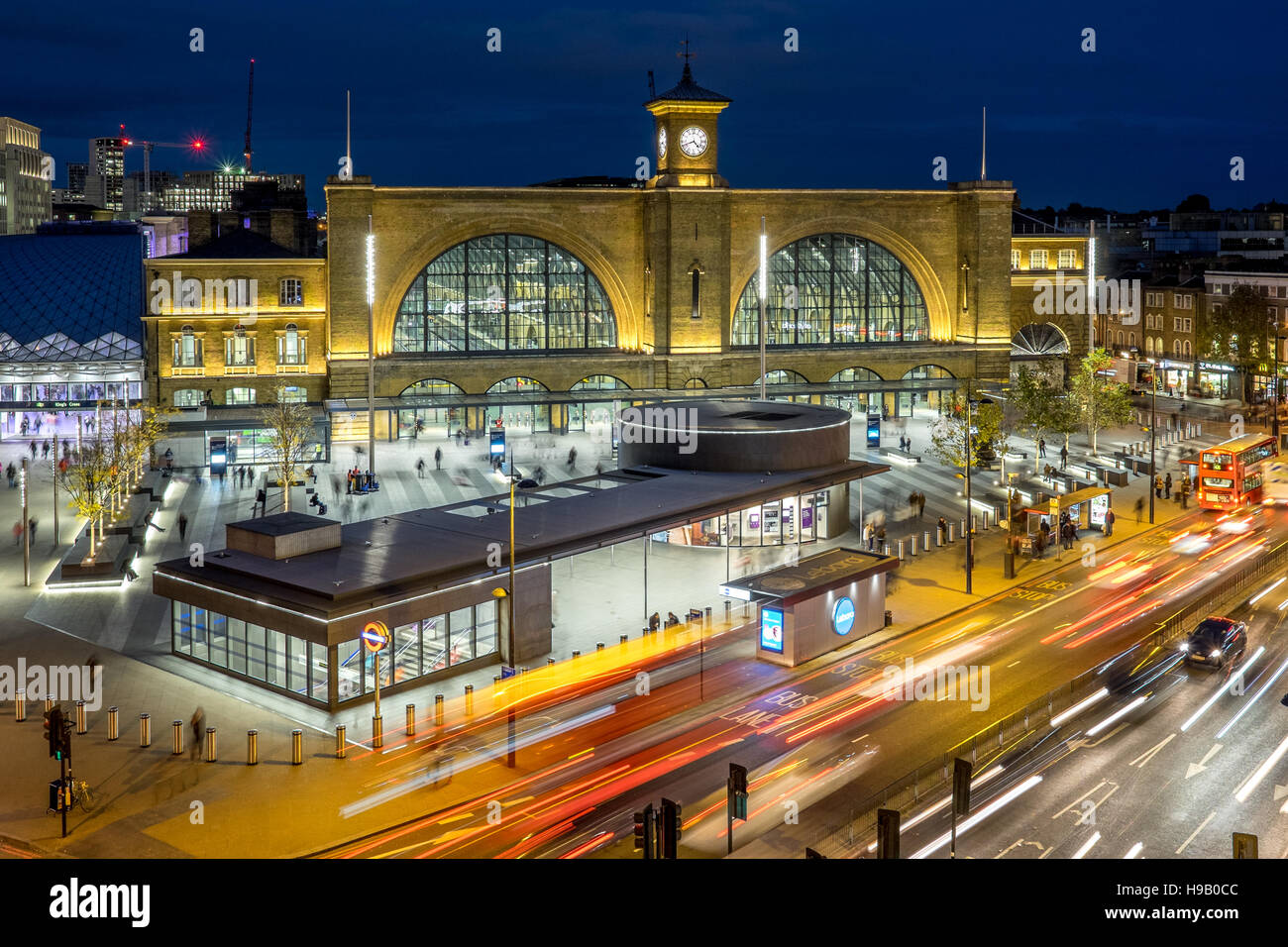 King's Kings Cross station national railway at night dusk sunset in London with busses bus tube underground - Stock Image