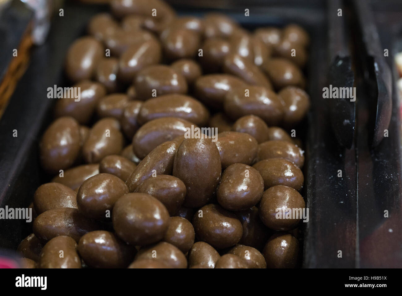 Chocolate beans in tray at artisanal Christmas market Stock Photo