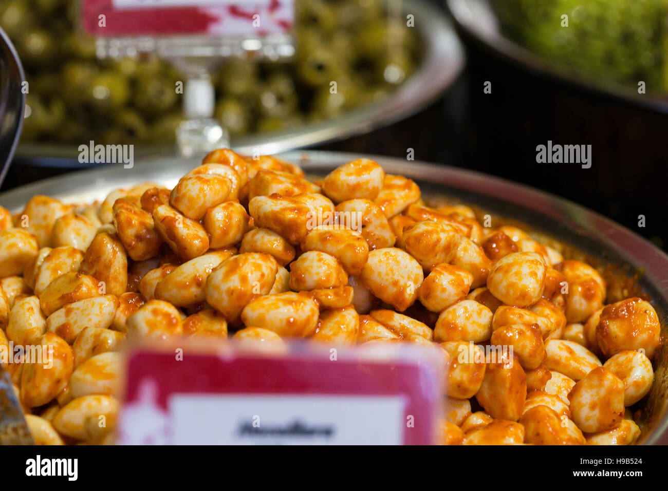 Fresh food produce in silver bowls with price signs at farmers Christmas market, deli - Stock Image