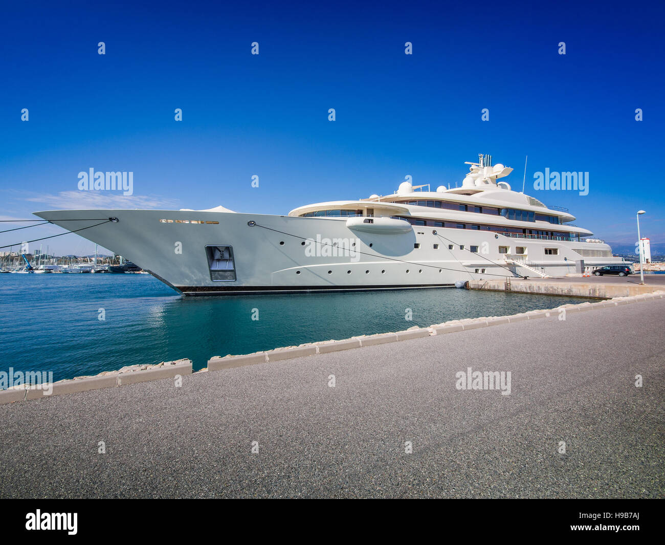 Mega yacht belonging to the very rich moored in the port of Antibes, France - Stock Image