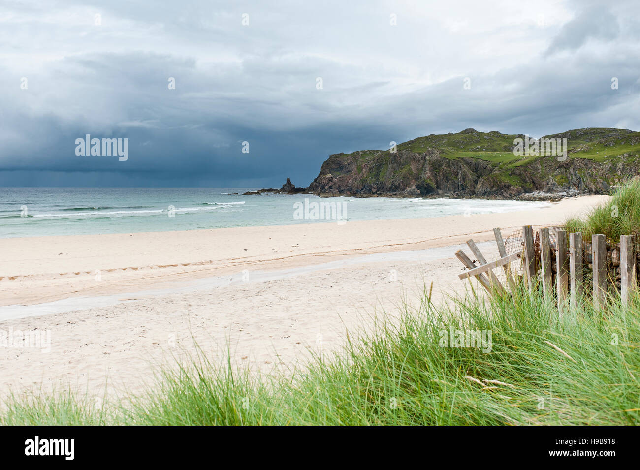 Sandy beach with dark clouds over the coast, Dail Mòr Beach, Dalmore, Carloway, Isle of Lewis, Outer Hebrides, - Stock Image