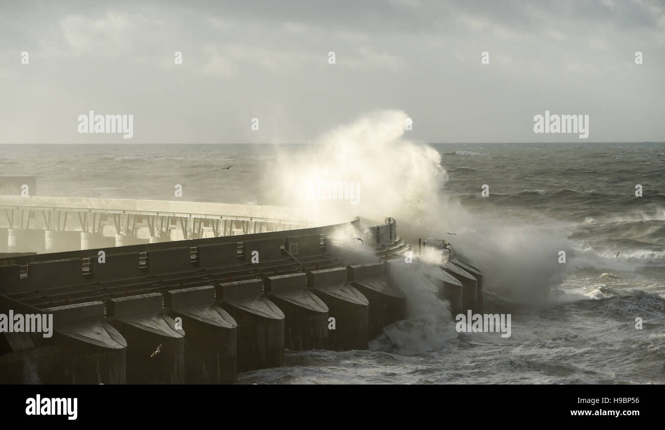Brighton Sussex, UK. 22nd Nov, 2016. Waves crash over Brighton Marina as the end of Storm Angus blows itself out - Stock Image