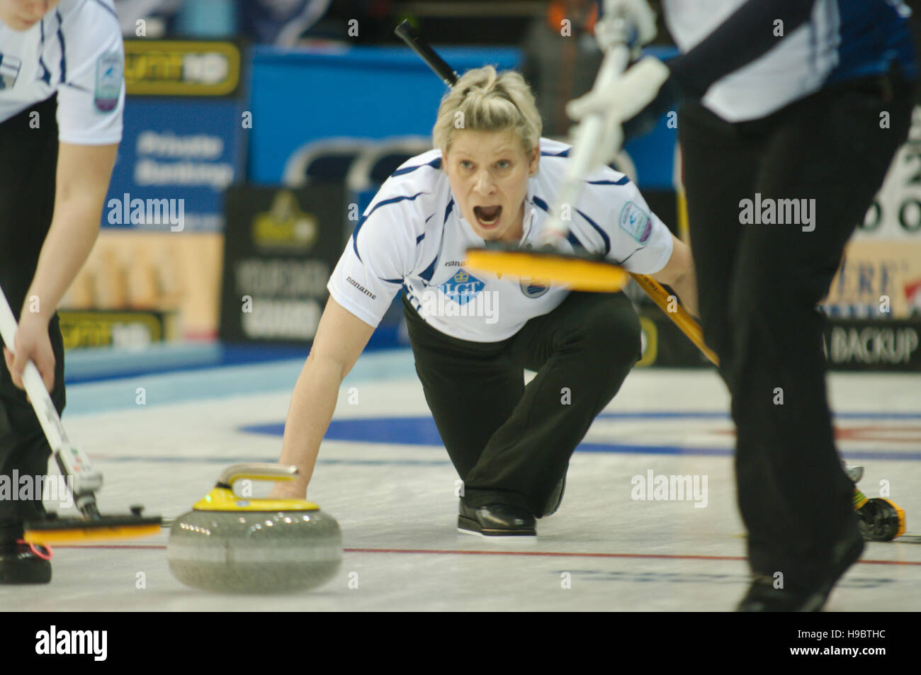 Braehead Arena, Renfrewshire, Scotland, 22 November 2016. Anne Malmi, skip of Finland,delivering a stone and shouting - Stock Image